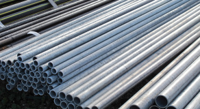pile of iron pipes for the transport of electrical cables and op